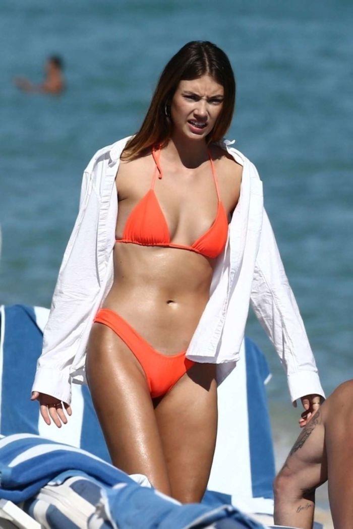 Lorena Rae Tanning In An Orange Bikini On The Beach In Miami
